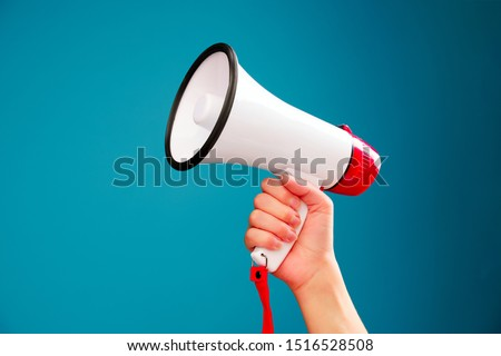 Picture of hand with mouthpiece on empty blue background