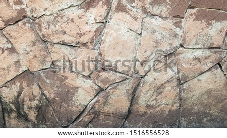 Gray stone wall background. The texture of the stone. Old castle wall background. Stone wall as a background or texture. Part of the wall, for background or texture. #1516556528