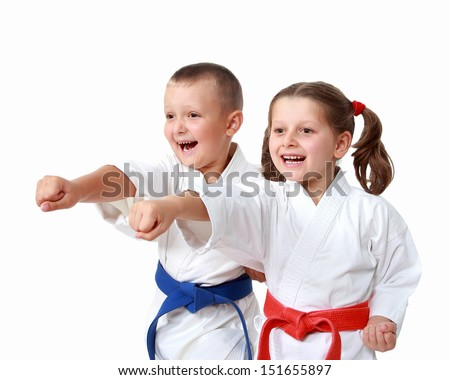 Happy athletes in a kimono beat punch arm Royalty-Free Stock Photo #151655897