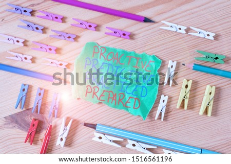 Writing note showing Proactive Predictive Practiced Prepared. Business photo showcasing Preparation Strategies Management Colored clothespin papers empty reminder wooden floor background office. #1516561196