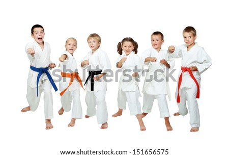 Young children in kimono perform techniques karate on a white background Royalty-Free Stock Photo #151656575
