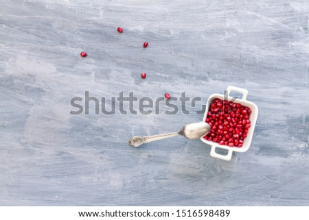 Pomegranate Seeds in a white bowl. Top view or overhead view composition with copy space #1516598489