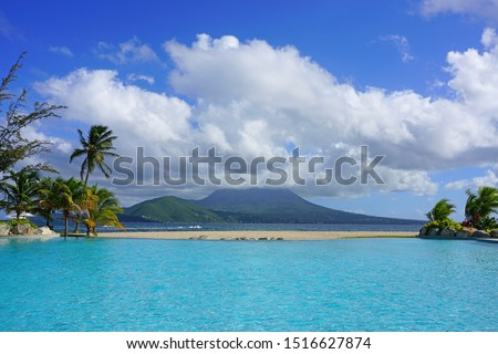 Day view of the Nevis Peak volcano across the water from St Kitts #1516627874