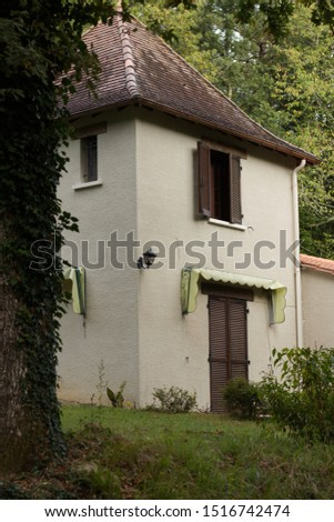 A very small French house situated in woodland.  #1516742474