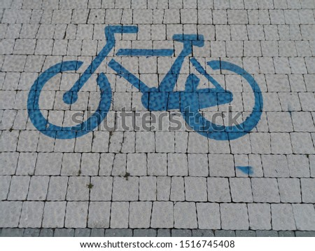 light grey block cycle way with blue painted icon symbol sign #1516745408