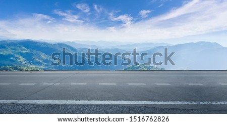 Empty highway asphalt road and beautiful sky mountain landscape Royalty-Free Stock Photo #1516762826