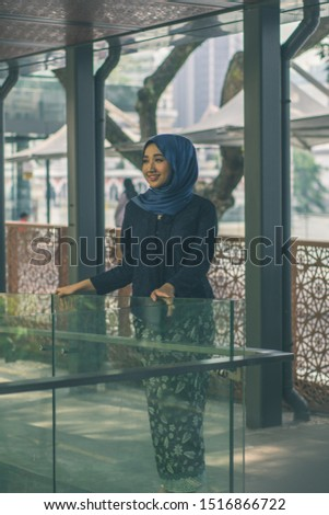 Kuala Lumpur, Malaysia – August 18, 2019: A fashion portrait of young and attractive Muslim Malay woman in the city. #1516866722