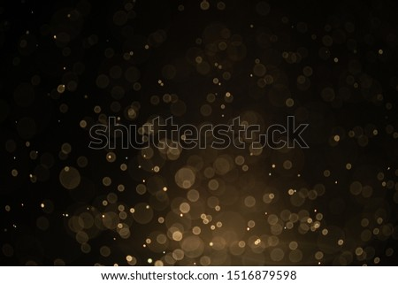 Texture background abstract black and gold Glitter and elegant for Christmas Dust white. Sparkling magical dust particles Magic concept Abstract background with bokeh effect.