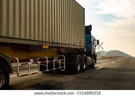 Cargo Truck on highway road with container, transportation concept.,import,export logistic industrial Transporting Land transport on the expressway.motion blurred to soft focus #1516880318