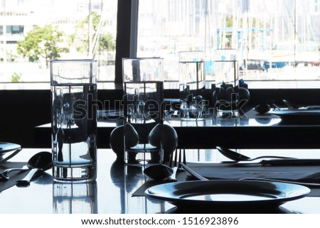Glass of water on the table in a restaurant #1516923896