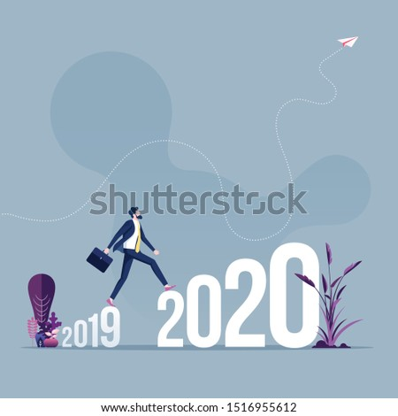 Businessman walk across between 2019 to 2020 new years #1516955612