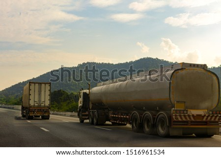 Gas Truck on highway road with tank oil  container, transportation concept.,import,export logistic industrial Transporting Land transport on the asphalt expressway with mountain and sky sunset #1516961534