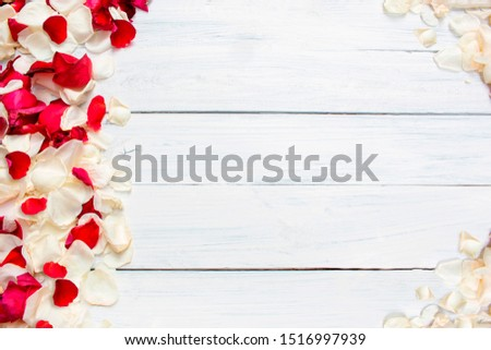 Red and white rose petals border on a white wooden background. Place for text. Top view.  #1516997939