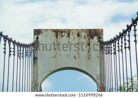 Ancient suspension bridge,Suspension bridge and blue sky. #1516998266