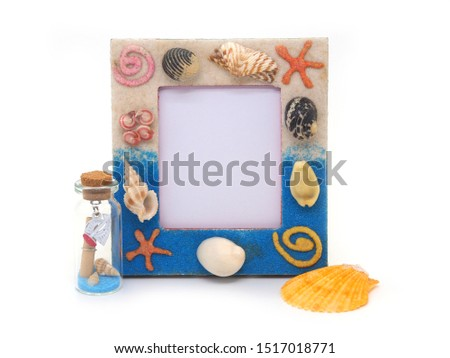 Blue picture frame  sea shell isolated on white background.