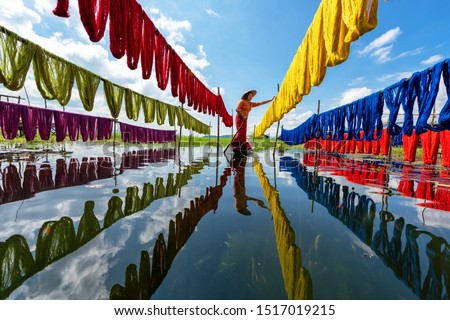 Handcrafted colorful lotus fabrics made from lotus fibers in Inle Lake, Shan State in Myanmar. These Inle handcrafted lotus fabrics are made using natural dyes and dried under sunlight. #1517019215