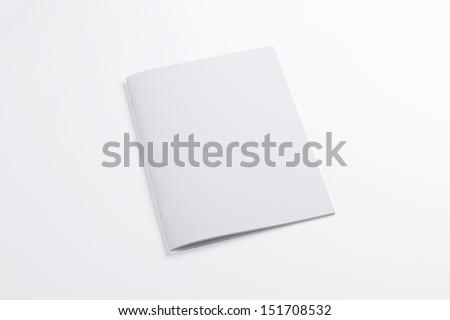Blank closed magazine isolated on white background