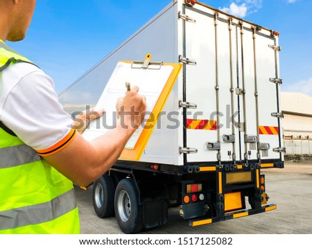 Worker hand holding clipboard  inspecting checklist load control the shipment with the truck container, Freight industry logistics and warehouse, Cargo courier shipment transport.   #1517125082