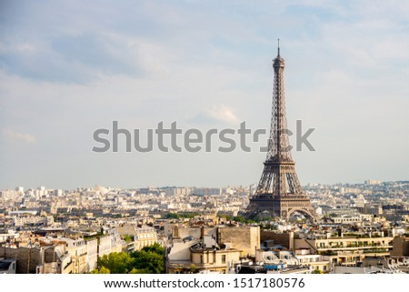View on the Eiffel Tower in Paris with white clouds in the background