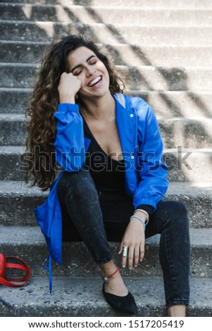 fashion portrait of a girl who sits on the steps #1517205419