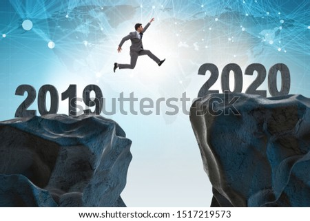 Businessman jumping from year 2019 to 2020 #1517219573