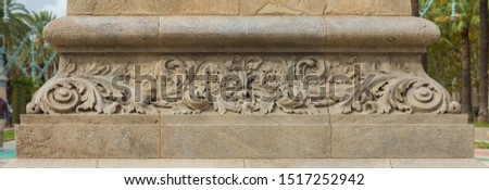 On the streets in Barcelona, public places. Elements of architectural decorations of buildings, gypsum stucco molding, wall texture and patterns.  #1517252942