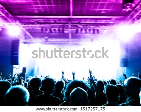 Concert blurred lights in a large crowded venue #1517257175