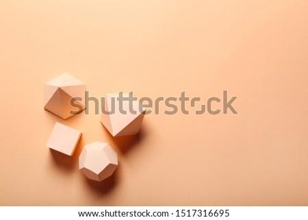Paper geometric figures on beige background #1517316695