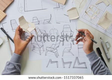Designer sketching drawing design development product plan draft chair armchair Wingback Interior furniture prototype manufacturing production. designer studio concept .                            #1517337065
