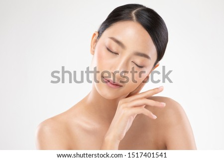 Beautiful Asian young woman close her eyes touching soft cheek smile with clean and fresh skin Happiness and cheerful with positive emotional,isolated on white background,Beauty and Cosmetics Concept #1517401541