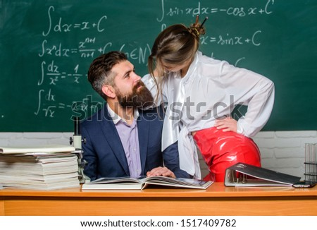 Intellectual intimacy. Sexy woman and bearded man feeling intimacy in class. Intimacy between teacher and student. Intimacy in school. Intimate relationship at work or study. #1517409782