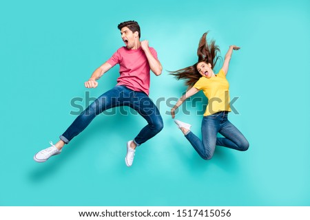 Full length body size view of his he her she nice attractive crazy funky cheerful couple jumping in air having fun fooling rejoicing isolated on bright vivid shine vibrant green turquoise background #1517415056