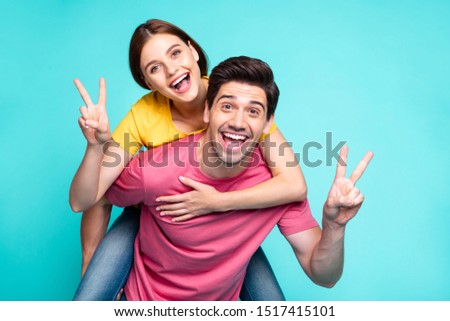 Portrait of his he her she nice attractive charming lovely glad cheerful cheery couple guy carrying girl having fun showing v-sign isolated over bright vivid shine vibrant green turquoise background #1517415101
