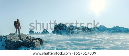 Climber on a summit freedom Royalty-Free Stock Photo #1517517839