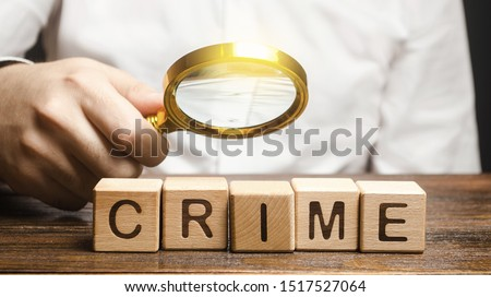 Man with a magnifying glass examines the word Crime. Investigation. Collection evidence, identification of perpetrators, familiarization with court case. Detective, criminal forensic expert. Expertise #1517527064