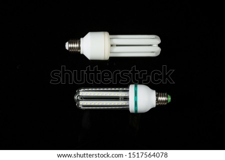 led and fluorescent energy saving lamps on black isolated background. on the glass #1517564078