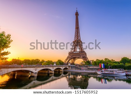 View of Eiffel Tower and river Seine at sunrise in Paris, France. Eiffel Tower is one of the most iconic landmarks of Paris. Architecture and landmarks of Paris. Postcard of Paris #1517605952
