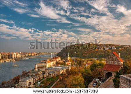 Amazing sky with picturesque clouds over Danube river and Buda hills in the central area of Budapest, Hungary. Castle gate tower, Danube embankment, Citadella and Gellert Hill on foreground #1517617910