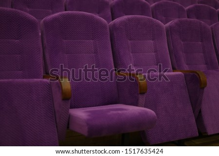 Purple soft velvet chairs in the theater hall #1517635424