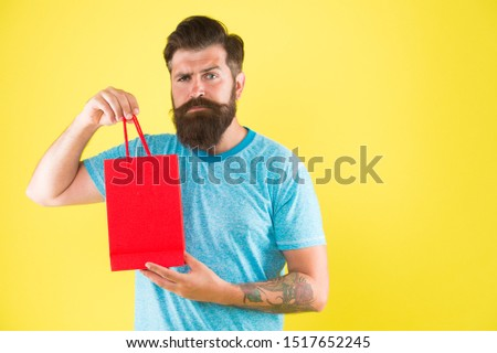 Male motives for shopping appear to be more utilitarian. Aspects can influence customer decision making behavior. Hipster hold shopping bag. Man with purchase. Impulse purchase. Purchase concept. #1517652245