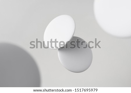 Design concept - top view of 2 white badge float on white background with blur effect for mockup, it's real photo, not 3D render