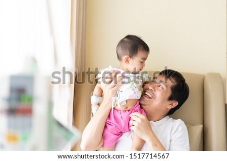 Asian father is playing and holding his baby to relax with love while the child admit as inpatient in the hospital, concept of parent take care to their sickness child in family lifestyle. #1517714567