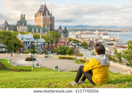 Canada travel Quebec city tourist enjoying view of Chateau Frontenac castle and St. Lawrence river in background. Autumn traveling holiday people lifestyle. #1517742056