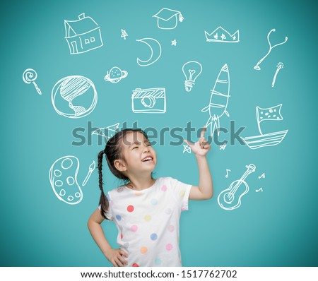 Asian child girl pointing at the blackboard with imagination the doodle art, Creative and dreams of childhood concept