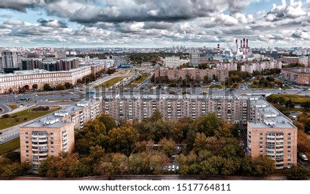 Panoramic high contrast aerial view of wide avenue in Moscow under dramatic sky in autumn with smoking tubes #1517764811
