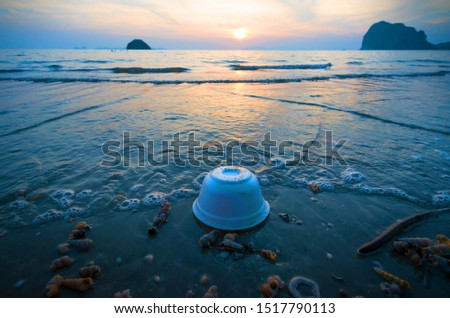 Styrofoam cup on tropical beach  pollutes the sea and marine life. Garbage rubbish trash problem environmental pollution. Concept of pollution control of the seas and oceans by single-use container. #1517790113