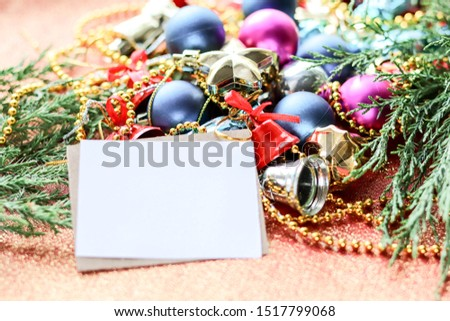 Christmas card. Christmas background. Christmas decorations and an envelope on a red background #1517799068
