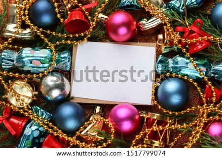 Christmas card. Christmas background. Christmas decorations and an envelope on a red background #1517799074