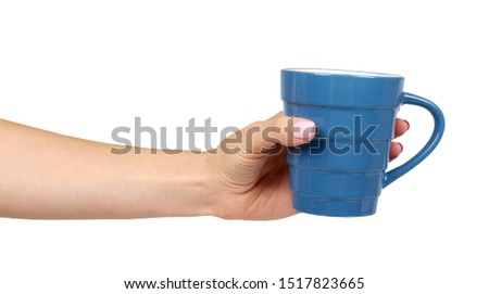 Hand with blue ceramic cup, mug for coffee and tea, kitchen pottery. Isolated on white background. #1517823665