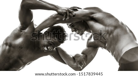 Two strong male black athletes wrestling. Rivalry.  Black and White.  #1517839445
